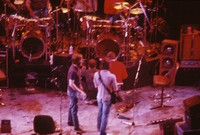 """Grateful Dead So Far"" production: Brent Mydland, Bob Weir, and unidentified crew members"