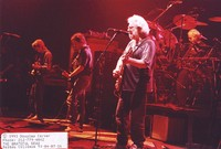 Grateful Dead: Jerry Garcia, with Phil Lesh, Bob Weir, and Bill Kreutzmann in the background