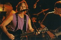 Bob Weir, with Phil Lesh in the background