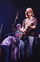Grateful Dead: Phil Lesh and Bob Weir, with an unidentified crew member (?)
