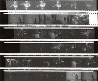 Musicians, Bill Graham playing ping pong, ca. 1974: contact sheet with 33 images
