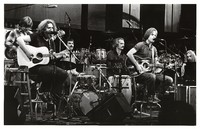 Grateful Dead during an acoustic set: Phil Lesh, Jerry Garcia, Mickey Hart, Bill Kreutzmann, Bob Weir, Brent Mydland