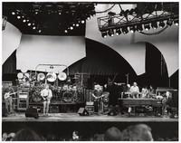 Grateful Dead: Phil Lesh, Bill Kreutzmann, Bob Weir, Mickey Hart, Jerry Garcia, Vince Welnick, and Bruce Hornsby, with Dennis McNally, their publicist, just below the stage