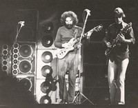 Grateful Dead, ca. 1974: Jerry Garcia and Bob Weir in front of the Wall of Sound