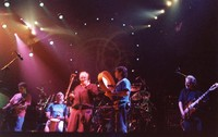 "Ken Nordine, with Bob Weir, Bill Kreutzmann, Mickey Hart, and Jerry Garcia, reciting either ""Flibberty Jib"" or ""The Island"" during ""Drumz"""