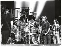 Grateful Dead: Bill Kreutzmann (obscured), Jerry Garcia (facing away from the camara), Mickey Hart, Bob Weir, Phil Lesh