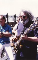 Jerry Garcia, with Bill Kreutzmann and Bob Weir in the background
