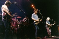 Grateful Dead: Phil Lesh, Bob Weir, Jerry Garcia, with Mickey Hart in background