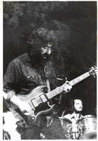 Grateful Dead: Jerry Garcia, with Bill Kreutzmann in the background