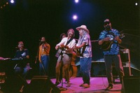 "Bruce Hornsby, Sherri Jackson, Rob Wasserman, Bob Weir, Arlo Guthrie, and Michael Falzarano performing ""Ripple"" during the acoustic jam"