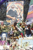 Memorial for Jerry Garcia: altar collection, mourner with large Gumby doll