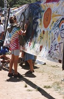 Memorial for Jerry Garcia: mourner writing on a banner