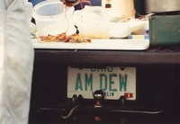 "Deadhead vehicle with ""AM DEW"" Ohio license plate, ca. 1990"
