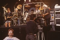 Grateful Dead, ca. 1990s: Bob Weir, Bill Kreutzmann, Mickey Hart, Jerry Garcia, with Dennis McNally and unidentified crew member