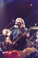 Grateful Dead: Jerry Garcia, with Bill Kreutzmann and Mickey Hart in the background