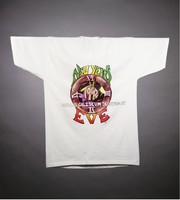 "T-shirt: ""Grateful Dead / 1992"" - skeleton in robe, hourglass. Back: ""New Year's Eve / Oakland Coliseum"", ""Deadicated in Memory of Bill Graham"""