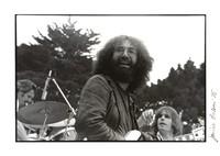 Grateful Dead: Jerry Garcia with Bob Weir and Bill Kreutzmann in background