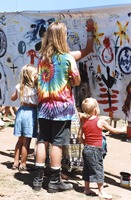 Memorial for Jerry Garcia: mourners with children, at the banner