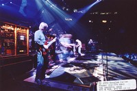 Grateful Dead: Phil Lesh, Bob Weir (blurred), Jerry Garcia, and Vince Welnick