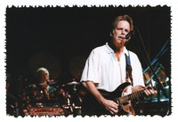 Bob Weir, with Bill Kreutzmann in the background